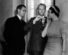 Ted Peckham demonstrates how to light a lady's cigarette